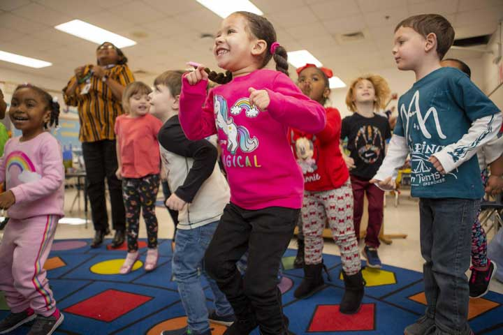 young children playing a self-regulation game, jump and freeze.